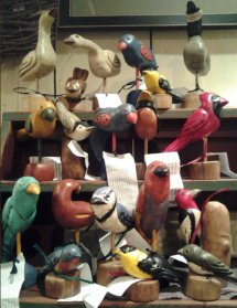 assorted painted wooden birds